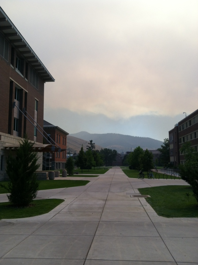 Smoke in the distance blocks the view of the mountains surrounding the valley