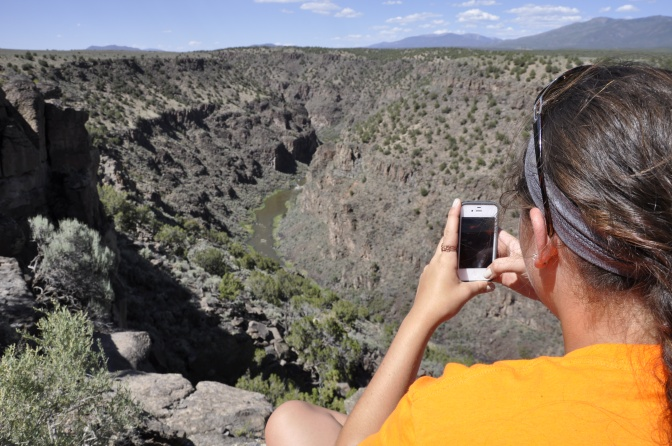 Charlotte taking an iPhone panorama of the gorge.