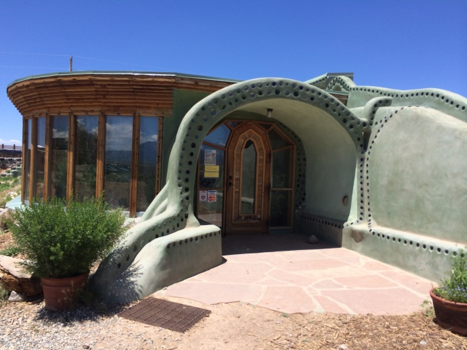 """""""Hobbit houses"""" built into the sand."""