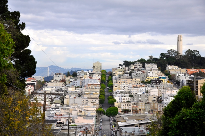 San Francisco as seen from the top of Lombard Street, Coit Tower on the right, Bay Bridge over to Oakland on the left.